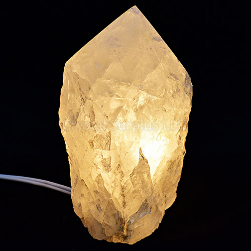 Clear Quartz Crystal Lamp with rough texture and polished pointed top